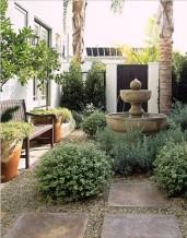 Informal Italian Courtyard with Birdsbath